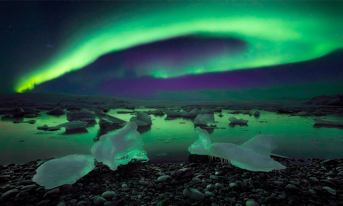 viaggio fotografico islanda aurora boreale lago